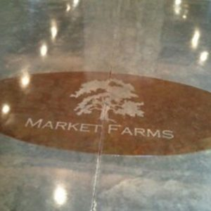 stained concrete floor with logo stamp