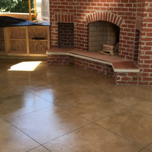 stained concreteoutdoor kitchen with diamond etching accent