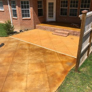 stained concrete backyard patio